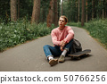 Young handsome man in a pink fashionable sweater 50766256