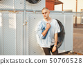 Handsome young bald man in a gray T-shirt 50766528
