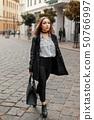 Young beautiful woman in autumn coat  50766997
