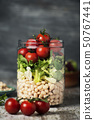 jar salad with white beans and vegetables 50767441