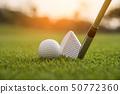 Golfer is putting golf ball on green grass at golf 50772360