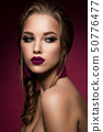 Make up. Glamour portrait of beautiful woman model with fresh makeup and romantic hairstyle. 50776477
