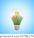 3d rendering of alphabet toy blocks on green grass inside of light bulb on blue background 50786179