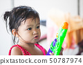 asian child girl play water with water gun 50787974