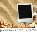 Picture frame on shells and sand background 50789759