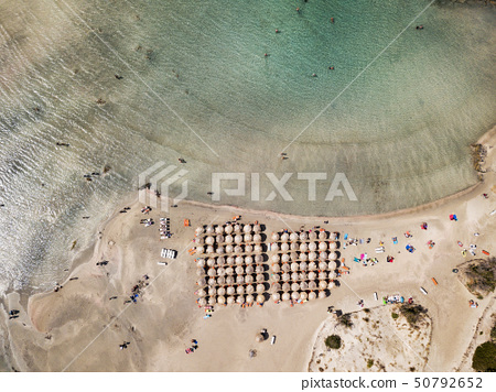 Aerial photo of Caribbean like beach with turquoise water and pink sand 50792652