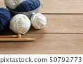 close up of yarn and wooden needles. 50792773
