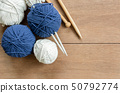 top view of yarn and needles on wooden table. 50792774
