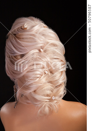 Hairstyle greek bride on the head of blonde woman isolated on studio background 50796587