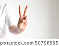 Hand show middle and indexfingers for counting two 50796995