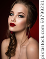 Make up. Glamour portrait of beautiful woman model with fresh makeup and romantic hairstyle. 50799231