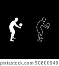 Volleyball player hits the ball with bottom 50800949