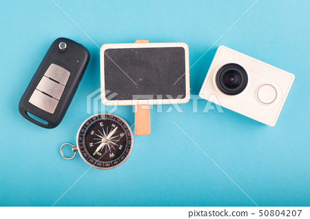 flat lay traveler accessories on blue background 50804207