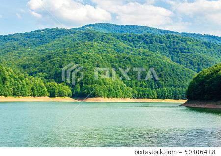 water storage reservoir in mountains 50806418