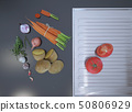 Fresh sliced vegetables lying on a gray table top 50806929