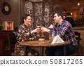 Couple in love on date drinking beer and having a good time. 50817265