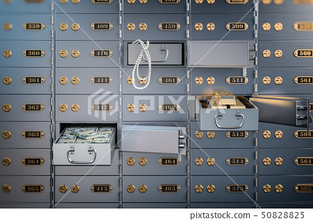 Open safe deposit box with money, jewels  50828825