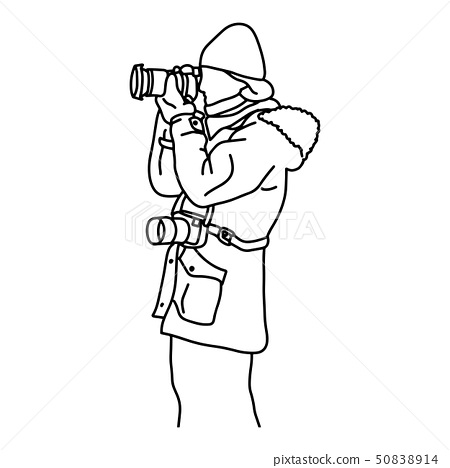 side view of photographer taking photo in winter 50838914