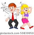 the woman and the man is dancing together  50839950