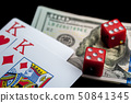 Close-up - playing cards and red gaming dices on black table. 50841345