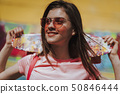 Close up pretty smiling girl with penny board 50846444