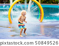 Kids at aqua park. Child in swimming pool. 50849526