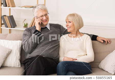 Connection With Relatives. Elderly Couple Talking On Phone 50855165
