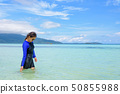 Asian woman walking in the sea at travel to Koh 50855988