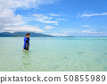 Asian woman walking in the sea at travel to Koh 50855989