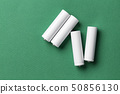 white batteries on a green background 50856130