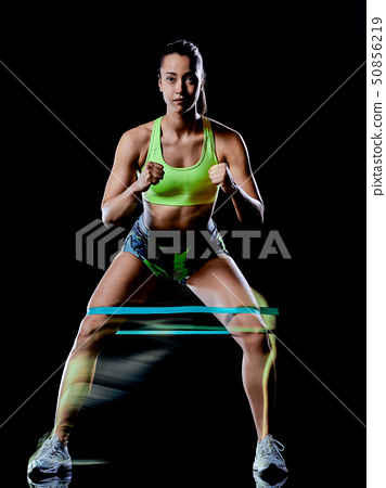 woman exercising fitness exercises isolated black background lightpainting effect 50856219