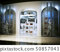 Entrance into a modern store selling handbags. 50857043