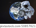 Giant astronaut near Earth planet with Moon 50857621