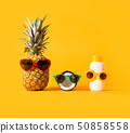 Pineapple and coconut wearing sunglasses with sunblock 50858558
