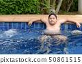 Obese boy relaxing enjoying hot tub 50861515