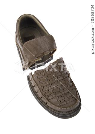 Damaged old shoes isolated on white background 50868734