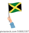 Jamaica flag in hand icon 50881597