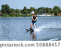 Man riding water skis 50888457