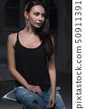 Young beautiful lady posing in studio. 50911391