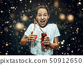 Woman drinking a cola 50912650