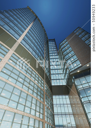 Urban Geometry, looking up to glass building. 50949233
