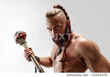 Man in leather viking's costume isolated on white studio background 50952678