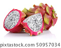 Half and whole dragon fruits isolated on white 50957034