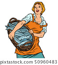 woman fisherman with a basket of fish. oceanic herring and cod 50960483