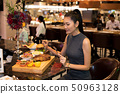Working Asian Woman Black hair having Lunch Dinner 50963128