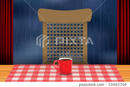 red coffee cup on the wooden table in the rainday 50983708