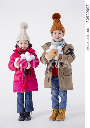Cheerful boy and a girl on the white background 266 50990007