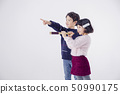 Cheerful boy and a girl on the white background 178 50990175
