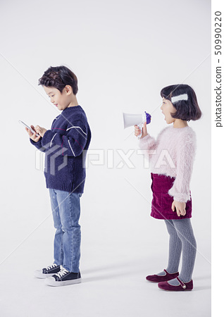Cheerful boy and a girl on the white background 117 50990220
