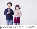 Cheerful boy and a girl on the white background 179 50990253